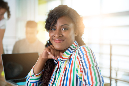 Photo for Creative african american businesswoman leading hes team in a friendly conversation about their next agency project - Royalty Free Image