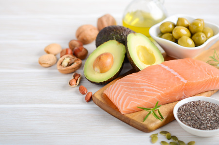 Foto de Selection of healthy unsaturated fats, omega 3 - fish, avocado, olives, nuts and seeds. - Imagen libre de derechos