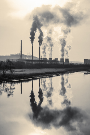 Photo for many large pipes of which goes dirty smoke, exhaust fumes and shepherds, above the city, the pollution of Wednesday - Royalty Free Image