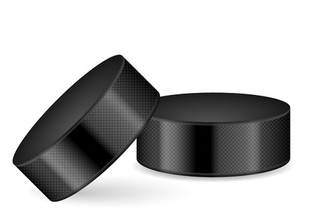 Hockey puck on a white background.