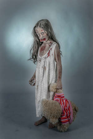 is a zombie girl dressed in a nightgown