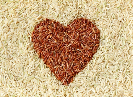 Brown rice and red rice with heart shape texture background