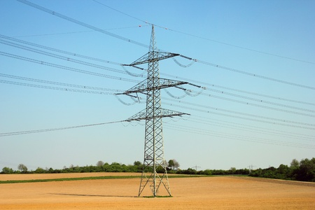 electric mast in the field at sunny weather