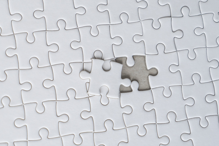 Photo pour Last piece of white jigsaw is almost in place for business solution concept - image libre de droit