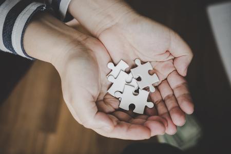 Photo pour Handful of jigsaws for business options concept - image libre de droit