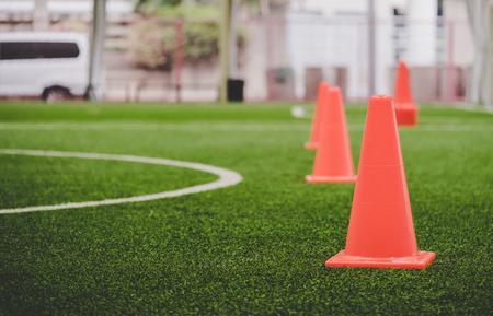 Foto de Orange soccer Training cone in soccer training ground - Imagen libre de derechos