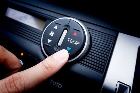 Foto per Finger pressing on Temperature switch of a Car air conditioning system - Immagine Royalty Free