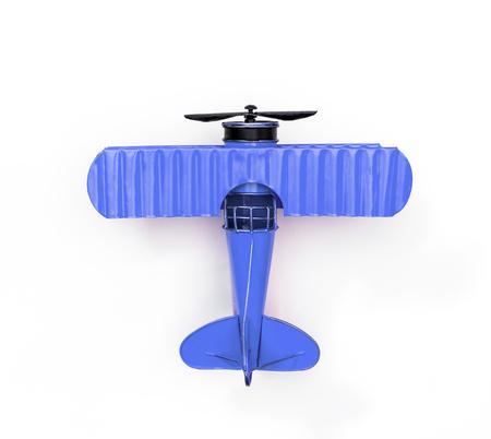Foto de blue Metal toy plane isolated on white - Imagen libre de derechos
