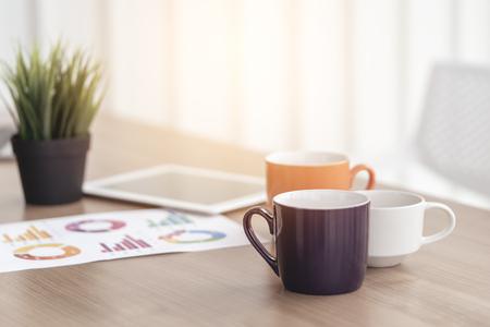 Foto de coffee on office table for break or breakfast business concept - Imagen libre de derechos