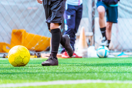 Photo for Children is training and dibbling ball in soccer training - Royalty Free Image