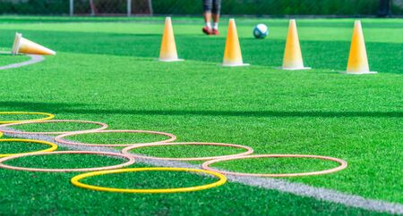 Foto de Soccer sport training equipments on green outdoor soccer training field - Imagen libre de derechos