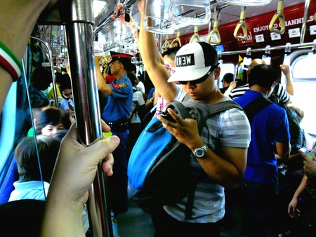 Commuters or passengers in a train in the philippines, manila