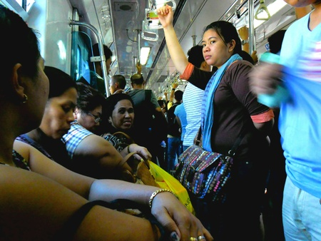 Passengers or commuters in the lrt or mrt in manila philippines in asia