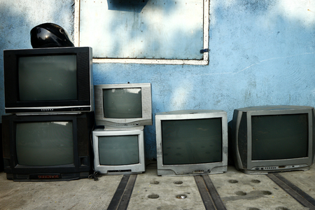 Foto per Photo of old and used television on display at a repair shop - Immagine Royalty Free
