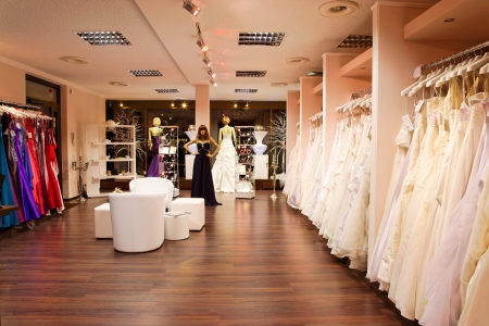Mannequins in wedding and evening gowns in the bridal shop.