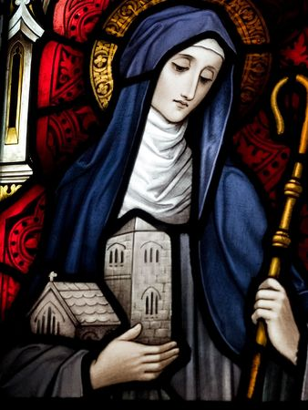 Stained glass in Catholic church in Dublin showing saint Brigid of Kildare The stained-glass windows are by the famous artist, William Early, who died during the commission