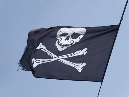 Pirate Flag flying on a blue sky