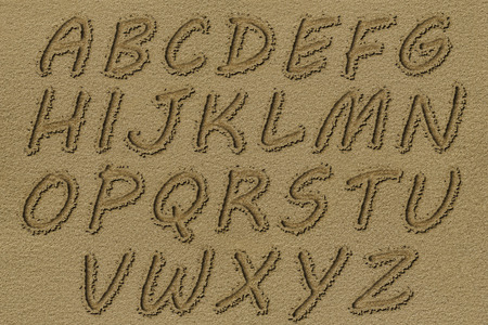 Photo for English alphabet written on a beach sand. - Royalty Free Image