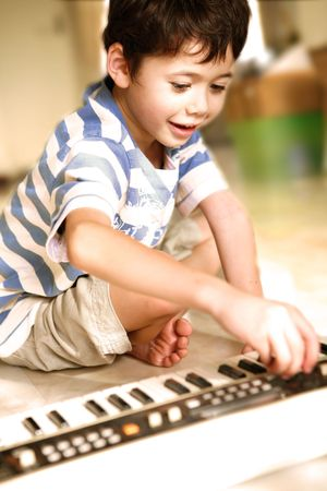 Young boy trying out an electronic keyboard.