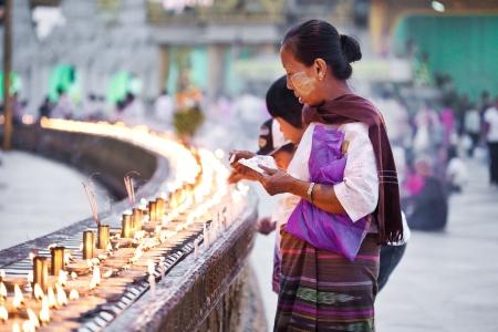 YANGON, MYANMAR - JAN 31  Buddhist devotees lighting candles at the full moon festival, Shwedagon Pagoda, January 31, 2010 in Myanmar  Burma