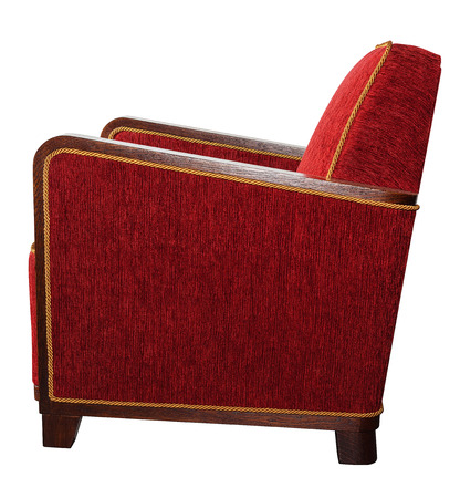Art Deco style upholstered red armchair with angular wooden armrests