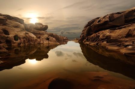 sunrise head dog at Sam Phan Bhok Grand Canyon, Mekhong river, Ubon Ratchathani, Thailand