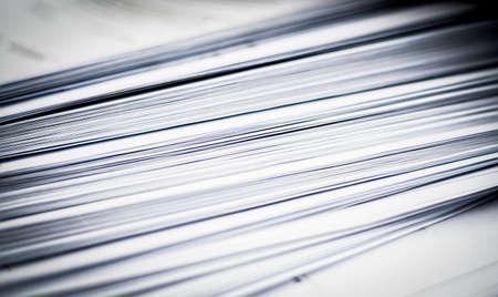 Photo pour A macro picture of a pile of paper. Defocused abstract lines, black and white design. - image libre de droit