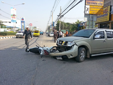 CHIANGMAI, THAILAND-JANUARY 10, 2013: Crash Accident Pickup Truck with Motorcycle at roadside in Chaingmai, Northern Thailand.
