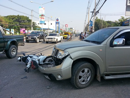CHIANGMAI THAILANDJANUARY 10 2013: Crash Accident Pickup Truck with Motorcycle at roadside in Chaingmai Northern Thailand.