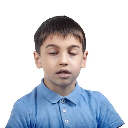 Photo for yawns bored boy in blue t shirt isolate - Royalty Free Image