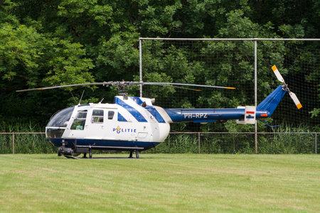 LEEUWARDEN, NETHERLANDS - JUNE 19: Netherlands Police Bo-105 helicopter on the sportfields of Leeuwarden airbase.