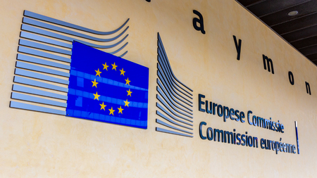 Foto de BRUSSELS, BELGIUM - JUL 30, 2014: EU sign at the entrance of the Berlaymont building in Brussels. The Berlaymont is an office building and it is the headquarters of the European Commission. - Imagen libre de derechos