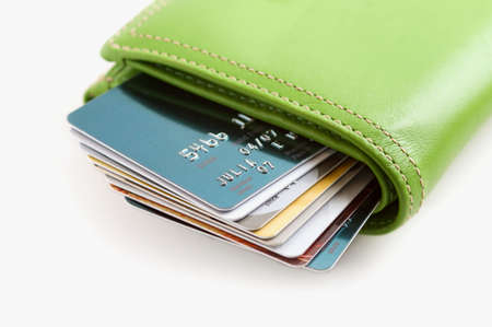 Green Leather Wallet Stuffed with Credit Cards. Carrying too much credit.
