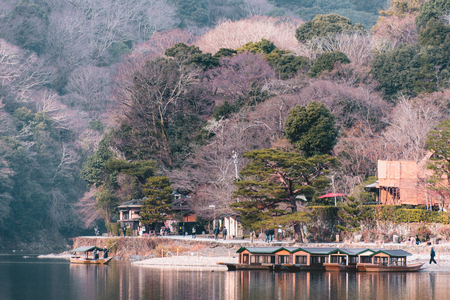 Kyoto, Japan - Jan 17, 2018. A tourist boat on Hozu River at Arashiyama in Kyoto, Japan. Arashiyama is a nationally designated Historic Site and Place of Scenic Beauty.