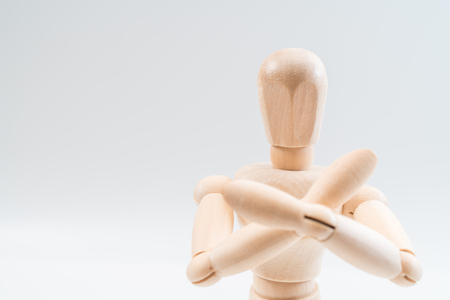 Photo for Refusal gesture, Wooden dummy, crossed hands on white background, copy space for your object or text - Royalty Free Image