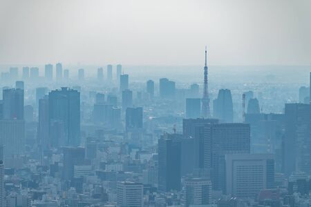 Photo pour dust during daytime in a very polluted city - in this case Tokyo, Japan. Cityscape of buildings with bad weather from Fine Particulate Matter. Air pollution. - image libre de droit
