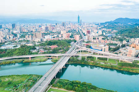Photo pour Taipei City Aerial View-Asia business concept image, panoramic modern cityscape building bird's eye view under sunrise and morning blue bright sky, shot in Taipei, Taiwan - image libre de droit