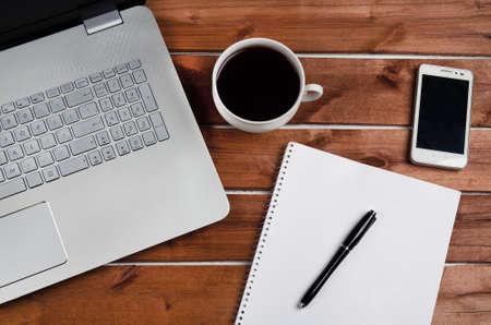 Foto für Coffee table with laptop and notebook - Lizenzfreies Bild