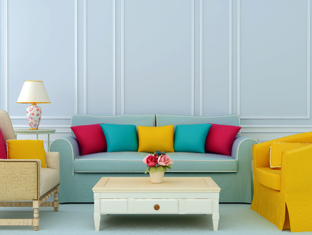 Beautiful composition of blue sofa and bright chairs with colorful pillowsの写真素材