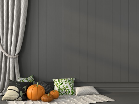 Pillows with print topical for Halloween against the backdrop of gray wall and curtain