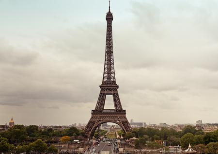 Photo pour The rain is getting closer to the best known landmark of Paris, the Eiffel Tower. - image libre de droit