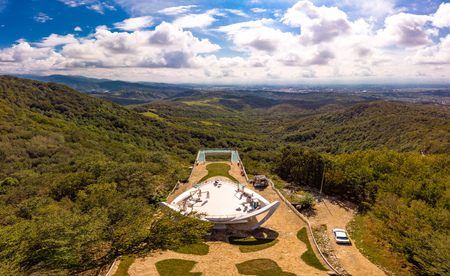 Kutaisi, Georgia. Beautiful Top view to glass bottomed Observation Platform With Clear Floor At Highest Point Of State Sataplia Reserve With Wonderful View Of Kutaisi from drone air.