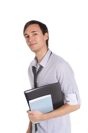 A handsome student holding his documents while standing in front of a white background.