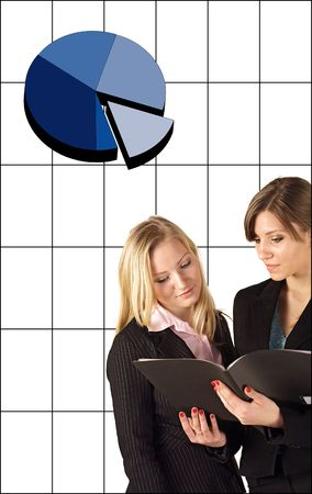 Two businesswomen reviewing something at their notebook computer. All isolated on white background.