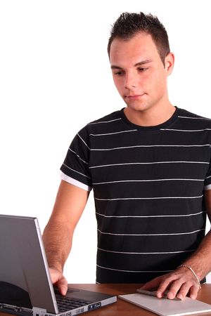 An ambitious student working at his notebook computer. All isolated on white background.