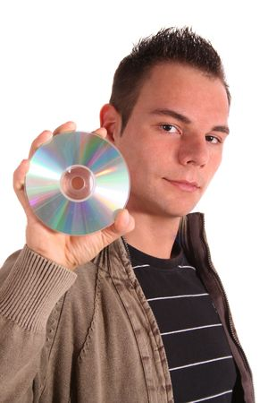 A handsome young man holding a cd or dvd. All isolated on white background.