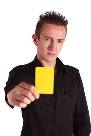 A young handsome man shows someone a yellow card. All isolated on white background.