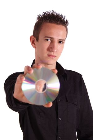 A young handsome man holding a cd or dvd. All isolated on white background.