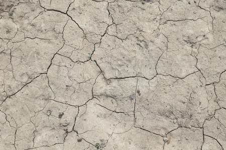 Background texture of a flawed dried out ground.