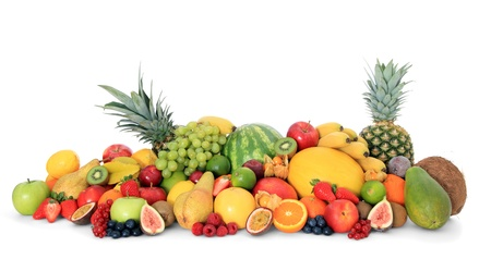 Pile of various ripe fruits on white background